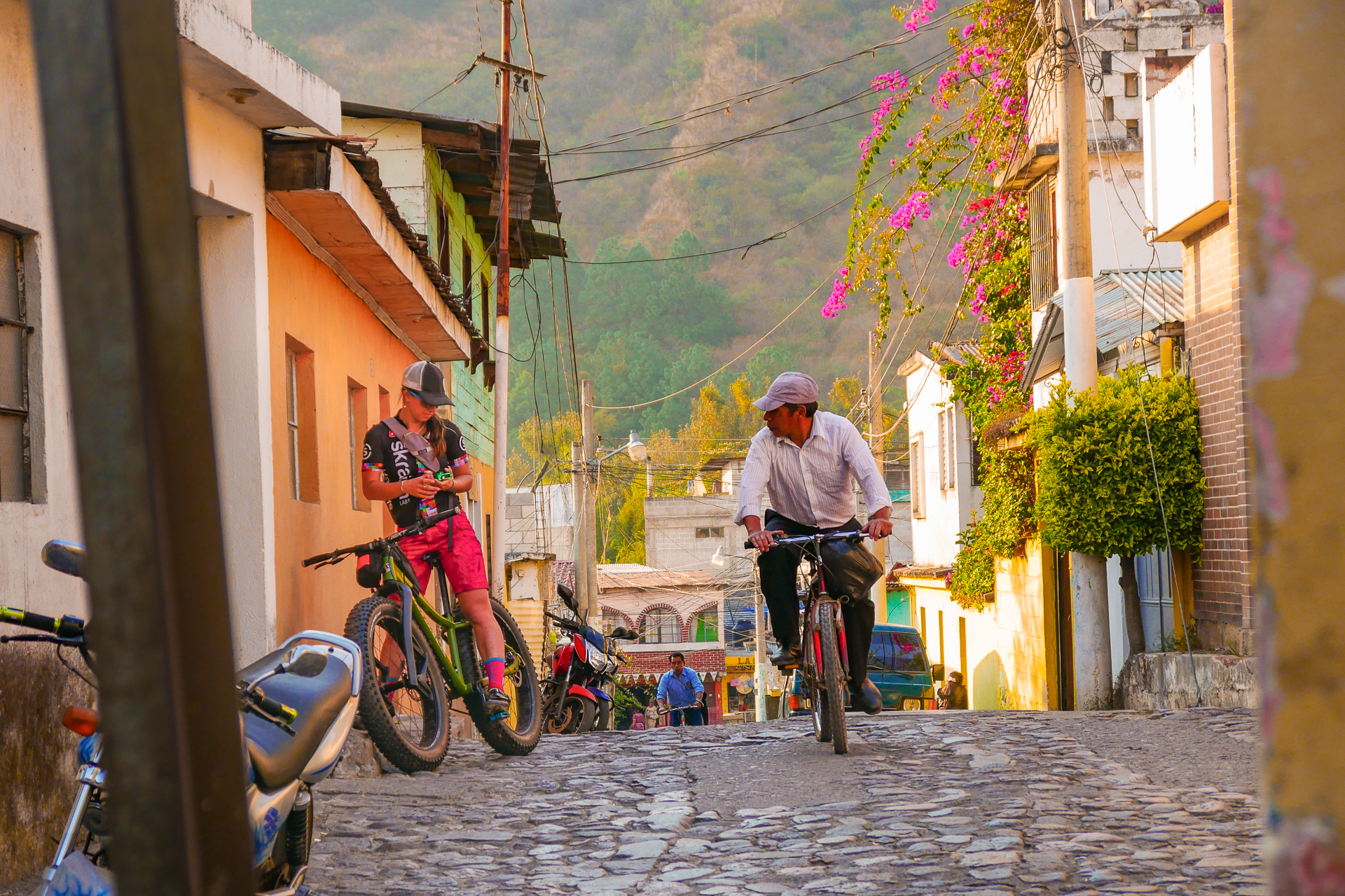 """Riding bikes for transportation and fun is part of the culture in Guatemala, regardless of age or class. Many people were curious about the """"bicigordas"""" - the fat bikes used on the volcanos expedition.  Rider: Elizabeth Sampy Location: Panajachel, Guatemala"""