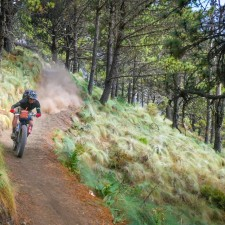 "Brendan James bombing the hiking trail to Volcán Acatenango (13,040ft) the loose volcanic soil provided the perfect terrain to shred Fat Bikes, their 5"" tires holding the corners a high speed on the 4,000ft descent."