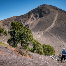 Liz cleans up after a rough fall. Volcanarchy:  Fatbiking Guatemala's Highest Volcanoes. Sponsors: Fatback Bikes, Lauf Forks, Gore Bike Wear, Julbo USA. | Ruta Volcán Acatenango , GuatemalaFilename: VC2016_EP03-ACAT-0329-G7-108Original Date: 03/29/2016© 2016 Brendan James Photography www.picsporadic.com