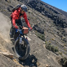 "Brendan James riding lines on the steep and loose volcanic terrain of Volcán Acatenango. The biking was similar to riding in deep snow, the 5"" tires of the Fatback Rhino providing perfect traction (no sinking!) 