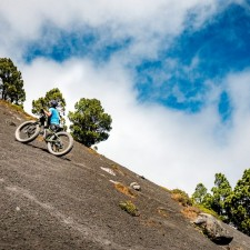 Liz Pushes the fatbike up Yepocapa, the steep secondary peak of Volcán Aacatenango. Hiking lines on the volcanic terrain. | Volcán Acatenango (3,880m) , GuatemalaFilename: VC2016_EP03-ACAT-0329-G7-121Original Date: 03/29/2016© 2016 Brendan James Photography www.picsporadic.com