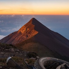 Sunrise from our summit camp atop Volcán Acatenango. Firey Volcán Fuego catching the morning rays. | Volcán Acatenango (3,880m) , GuatemalaFilename: VC2016_EP03-ACAT-0329-GH3-006Original Date: 03/29/2016© 2016 Brendan James Photography www.picsporadic.com