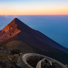 The dream realized: Volcánarchy 2016. Awaking at first light on the summit crater of Volcán Acatenango as the sun touches the easternflanks of the nearby and active Volcán Fuego (12,346ft and growing).Location: Volcán Acatenango Summit, Chimaltenango, Guatemala | Ruta Volcán Acatenango , GuatemalaFilename: VC2016_EP03-ACAT-0329-GH3-007Original Date: 03/29/2016© 2016 Brendan James Photography www.picsporadic.com