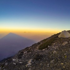 Sunrise and the eourmous silhouette of Volcán Acatenango streaching out across the chain of Guatemala's highest volcanos. From the Summit of Acatenango we could see almost all of them catching the morning light.   Volcán Acatenango (3,880m) , GuatemalaFilename: VC2016_EP03-ACAT-0329-GOPRO-11Original Date: 03/29/2016© 2016 Brendan James Photography www.picsporadic.com